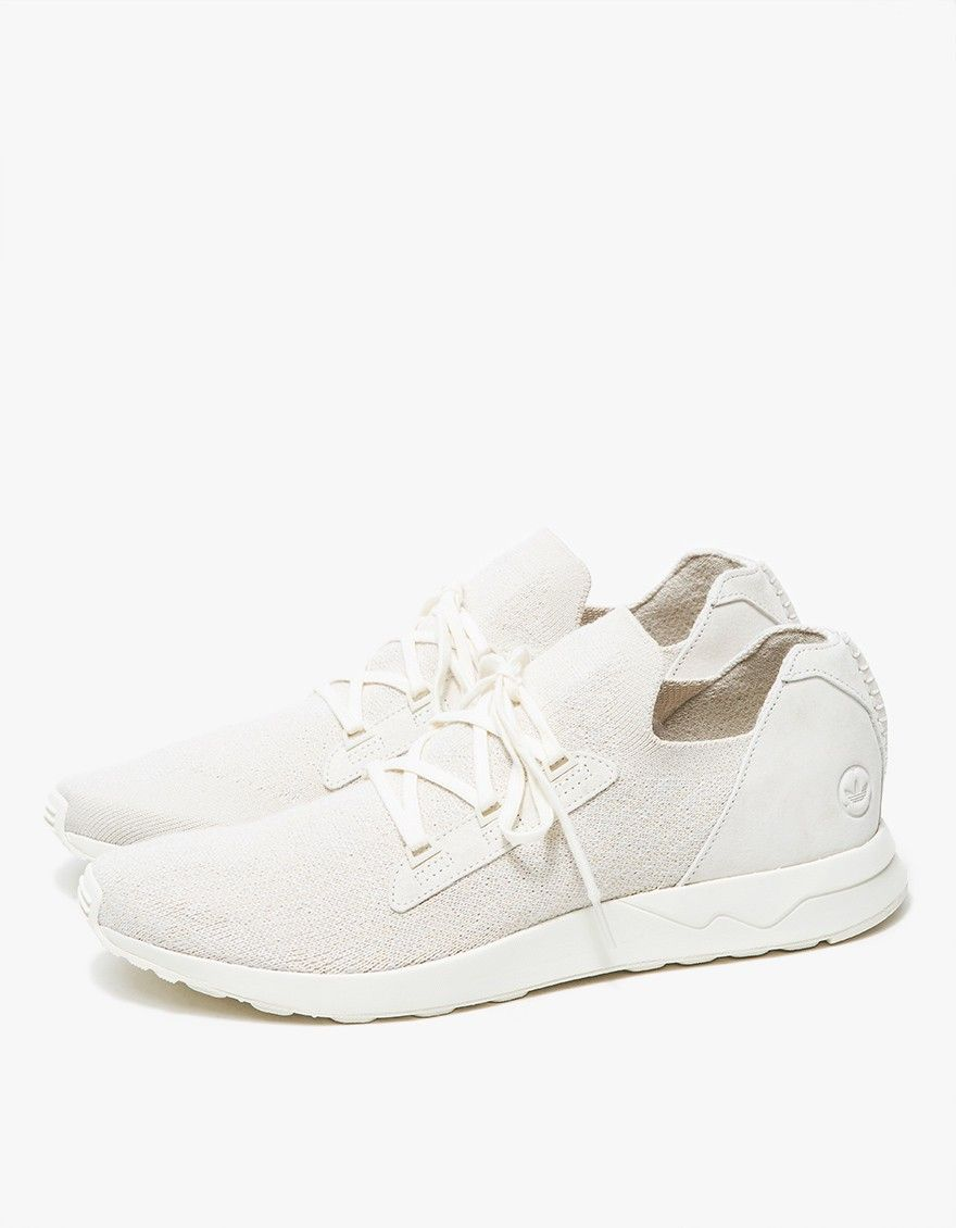 promo code ea735 7bc63 From Adidas in collaboration with Wings+Horns, a modern, minimalist sneaker  in Off White. Two-tone pattern primeknit upper. Molded suede heel cage and  ...