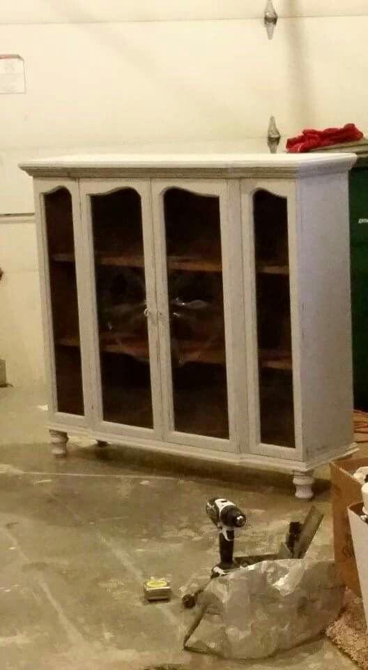 Top of a hutch repurposed into bookcase/cabinet