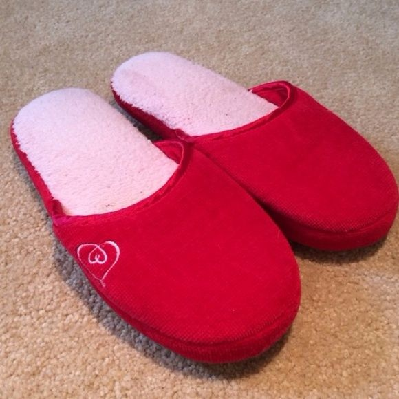 Victoria's Secret Slippers Victoria's Secret red heart slippers. In good used condition. Size medium which will fit a 6-9 Victoria's Secret Shoes Slippers