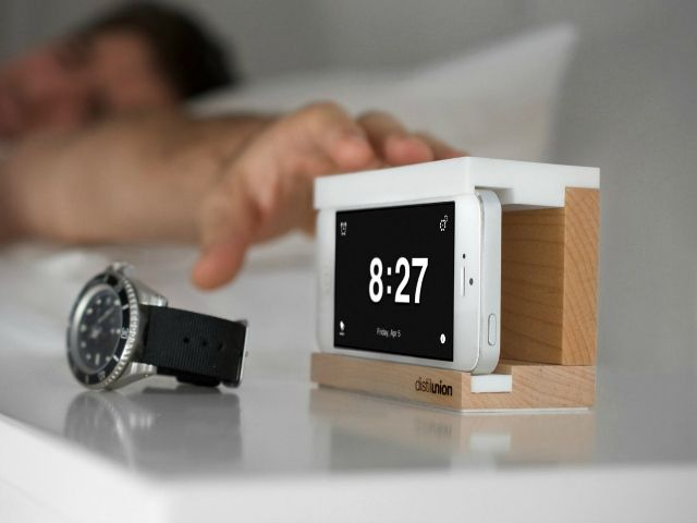 Snooze Alarm Dock is the iPhone dock you've been dreaming about. Give your iPhone a home on your nightstand plus a big, slap-happy snooze bar!