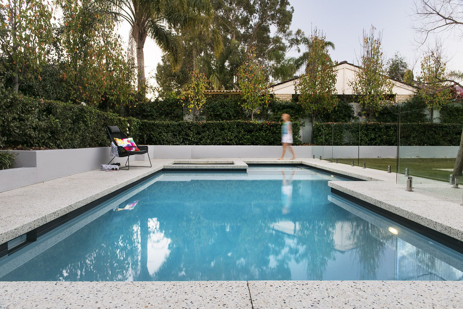 Decorative concrete pool surrounds options add value with for Swimming pool surrounds design