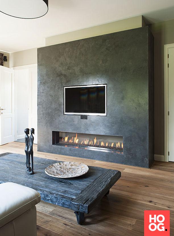 Luxe woonkamer inrichting met open haard   woonkamer ideeën   living ...