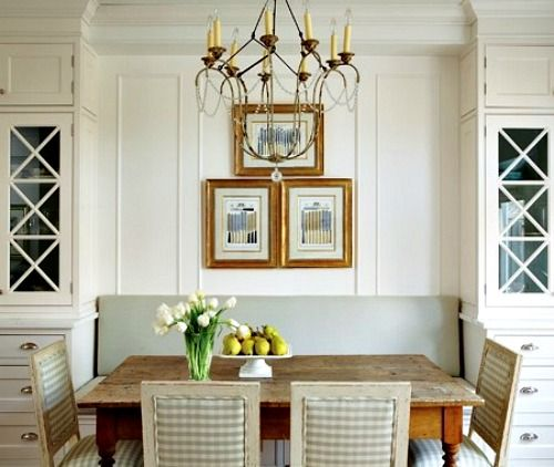 Elegant Dining   Banquette, Flanking Built Ins With A Unique Light Fixture.