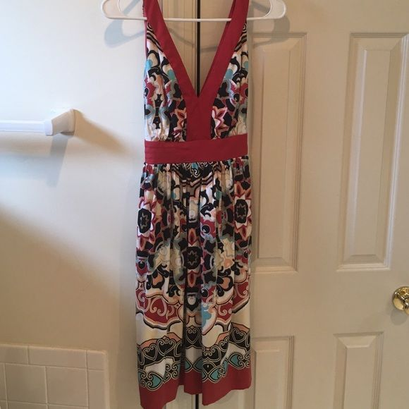 Trulli Women's dress size 8 Fun, sleeveless dress great for the summer! Deep 'V' in front and back. Waist sash ties in back. Excellent condition from smoke free home. Trulli Dresses