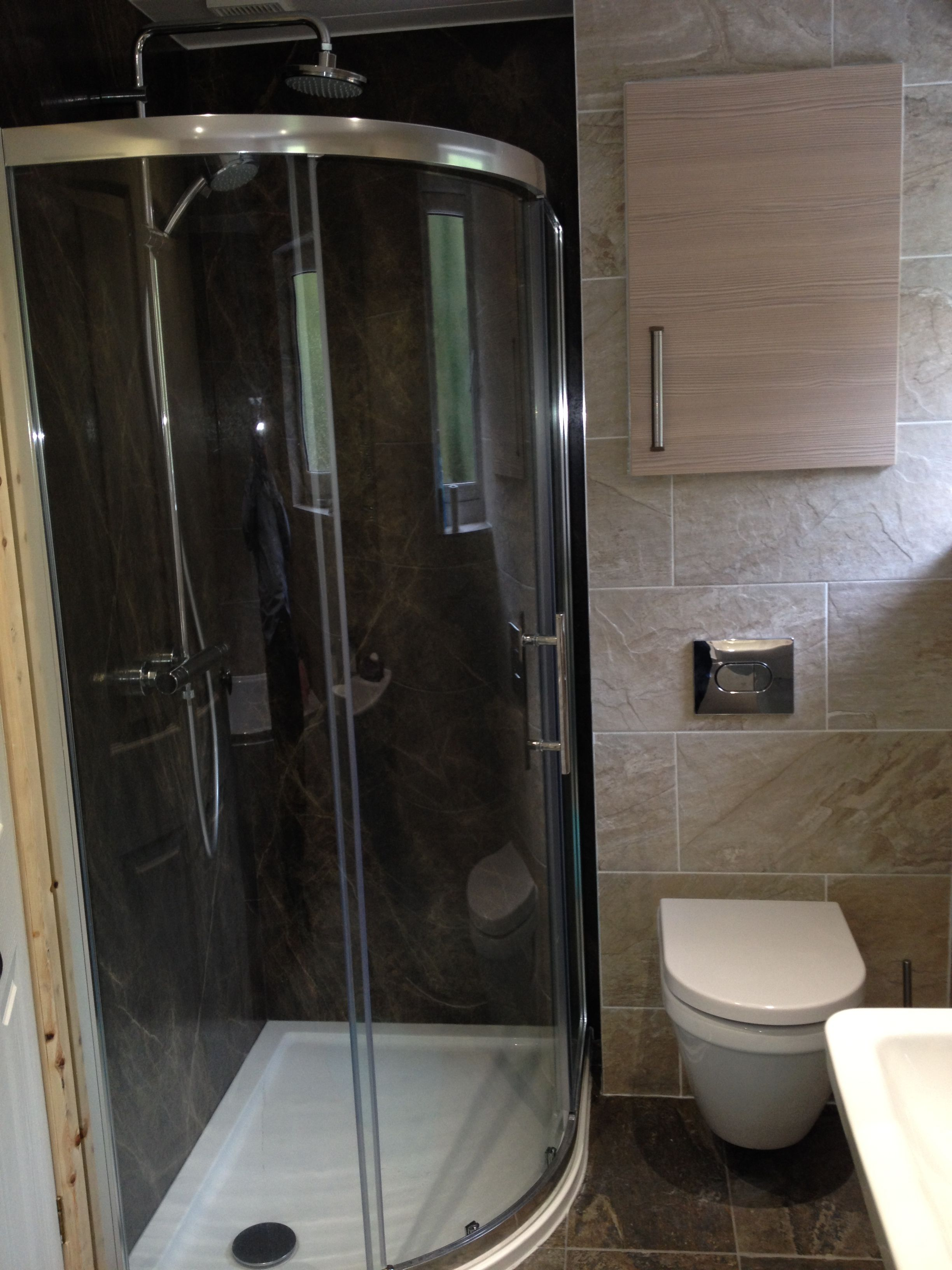 Using The Shower Wall As A Feature Is A Great Way To Add Character To A Room Usually Tying In With T Bathroom Shower Panels Bathroom Wall Panels Shower Panels
