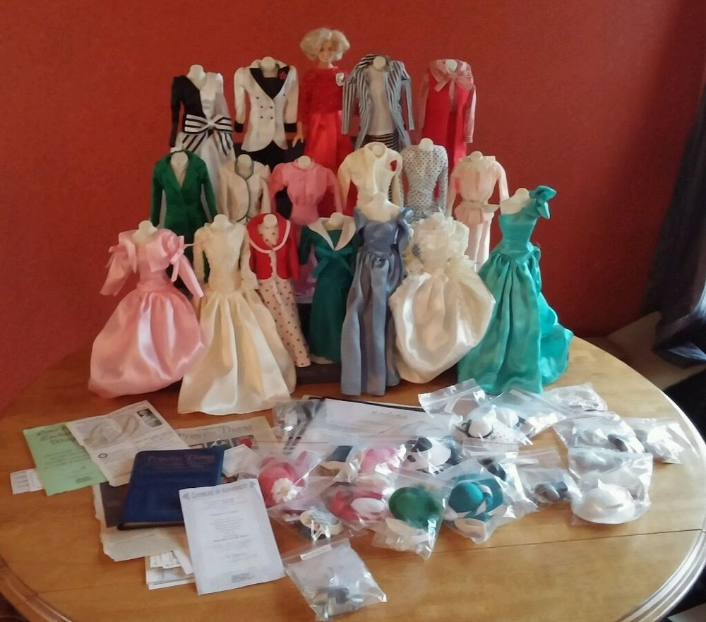 Vtg Princess Diana doll collection with wardrobe, stands, and display