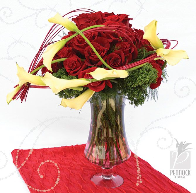 Graceful Calla Lilies And Classic Red Roses Combine For A Beautiful Valentine Arrangement Midollino Sticks Accent The Calla Lily Red Roses Beautiful Valentine