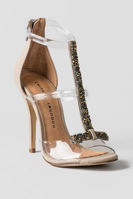 35c8663fa5 Elegant & chic, the Jive Talk Jeweled Heels are to die for! Available in  nude or black, these heels feature a clear lucite peep toe while gold &  silver gems ...