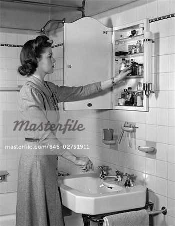 Old 1940s Medicine Cabinets 1940s Woman Reaching Into Bathroom Medicine Cabinet Stock Photo Bathroom Medicine Cabinet 1940s Woman Spanish Revival Bathroom