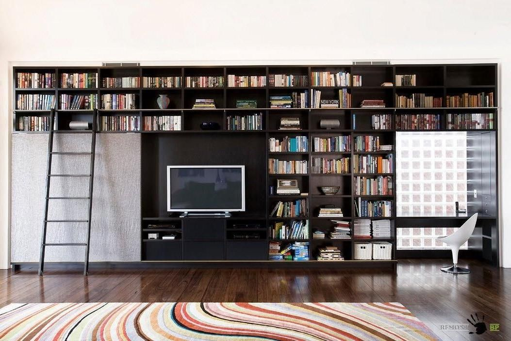A Large Black Wooden Library With Staircase And Sliding Partition Ideas Along Flat Tv Cabinet Also Colorful Rug In Living Room Interior