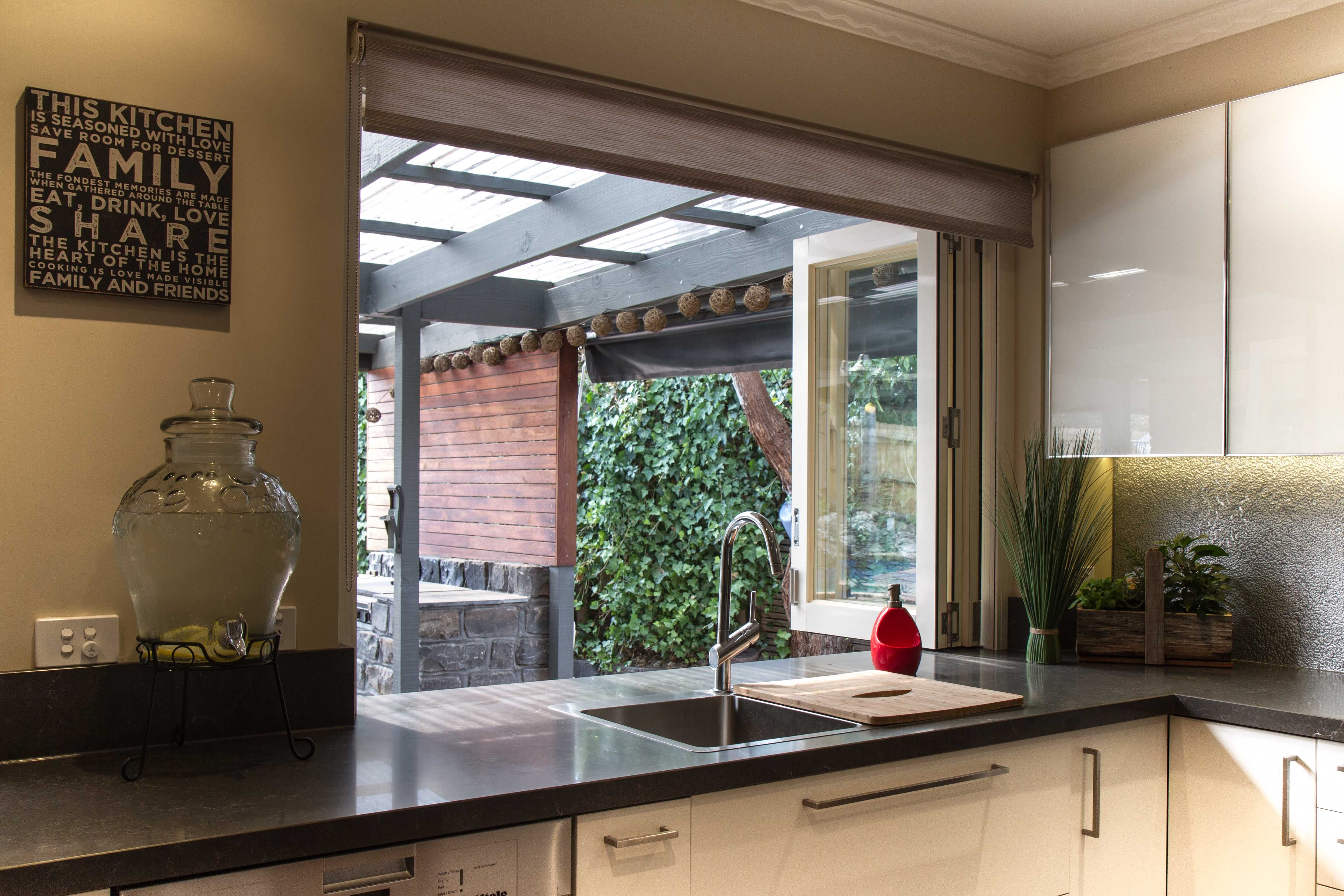 Modern kitchen. Servery window. Fold up windows at sink