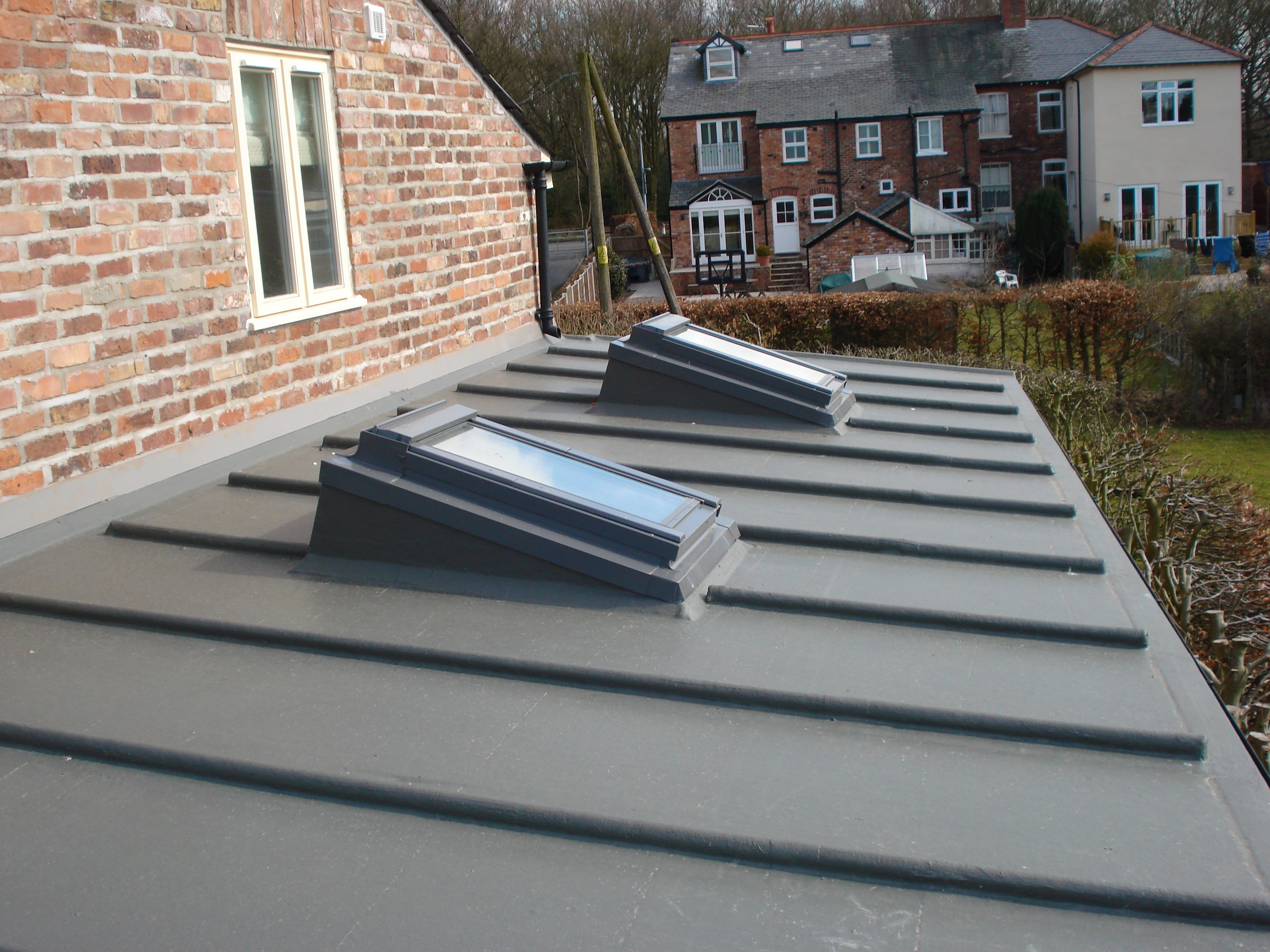 Lead roll finishes can make a flat roof more attractive for Garage roofing options