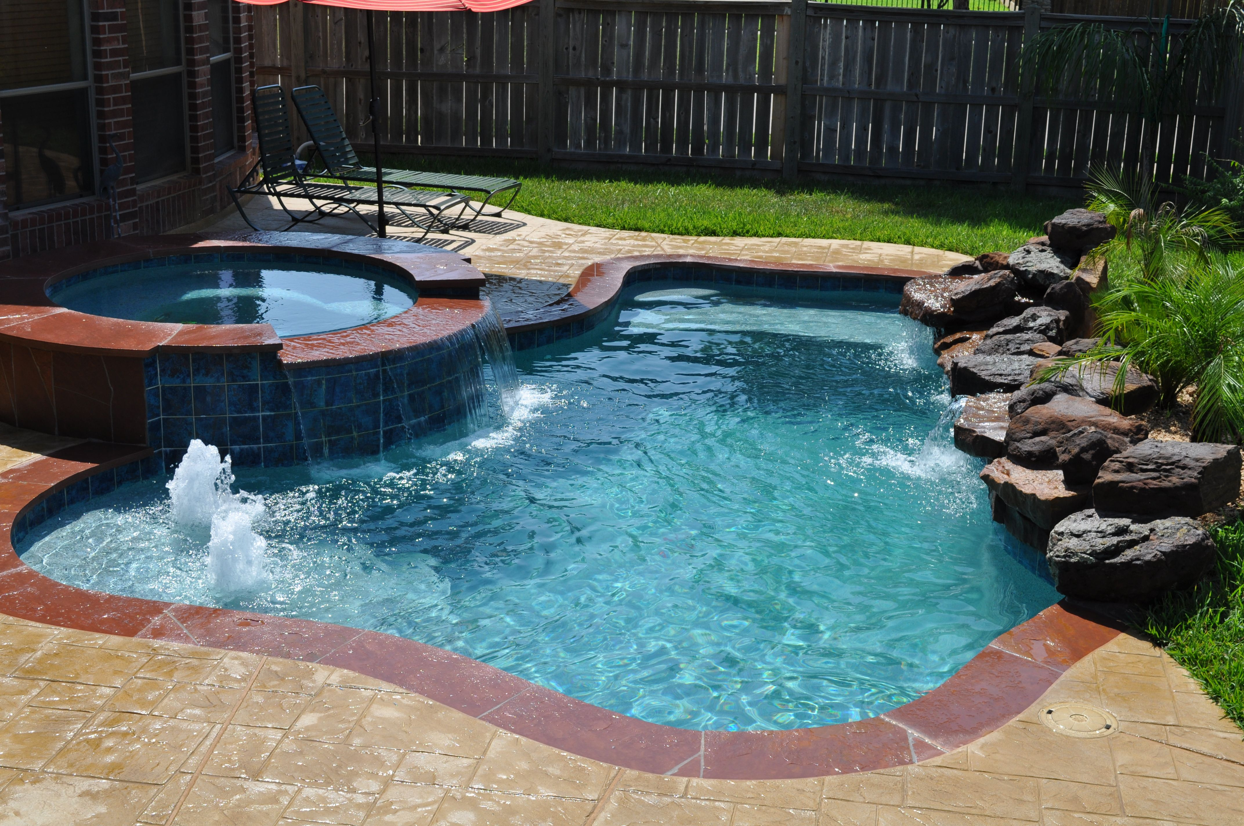 This small pool and spa in katy tx houston tx features for Pool design katy tx