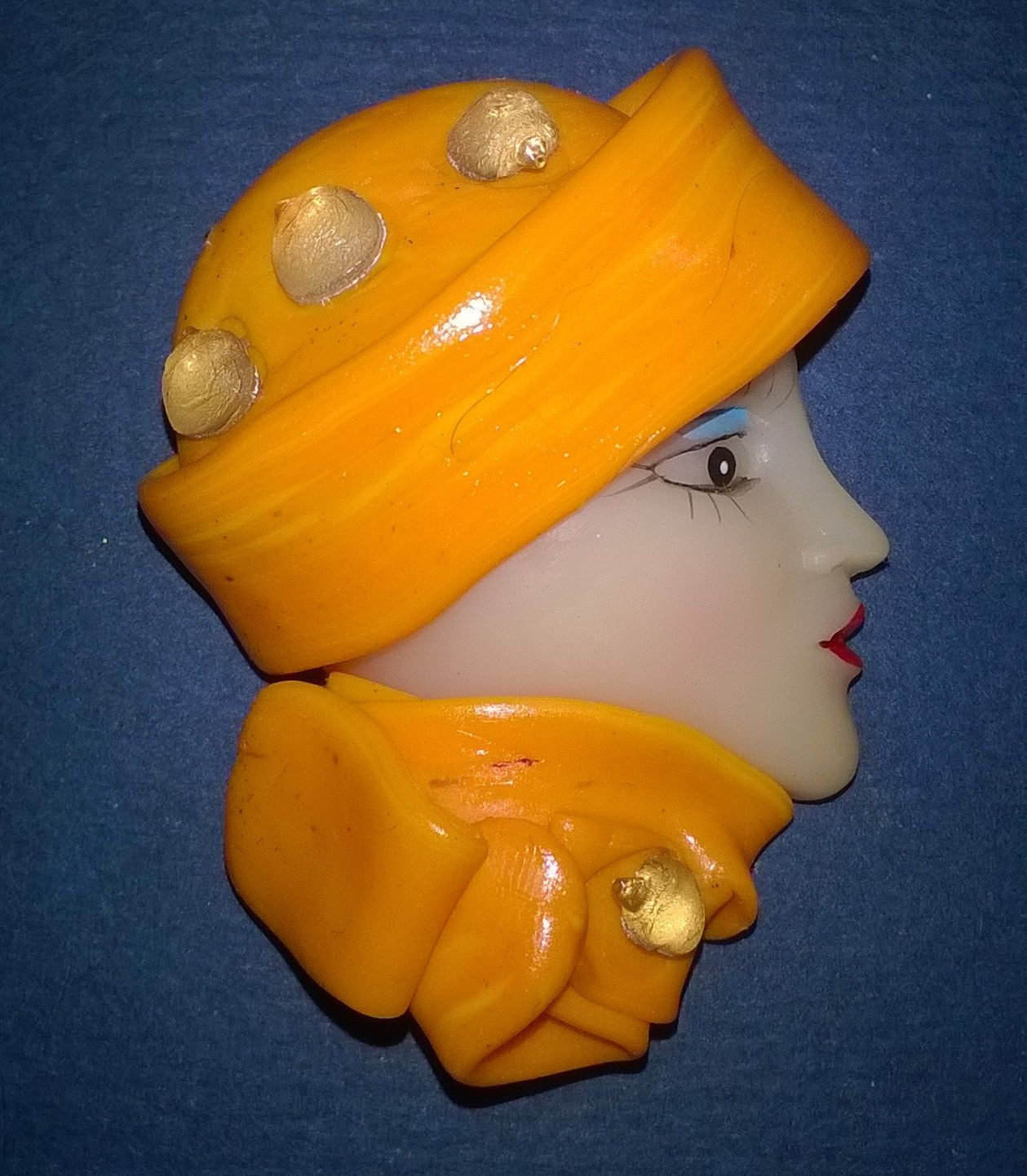 Side facing Lady Face Brooch with yellow hat and scarf by Jemmanda on Etsy