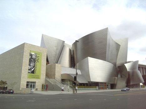 """Frank O Gehry. Disney Concert Hall  Need to go see a show here, too bad they mostly play classical music.  You see this building a lot in graphic design, most recently its part of Troikas """"Starz"""" redesign."""