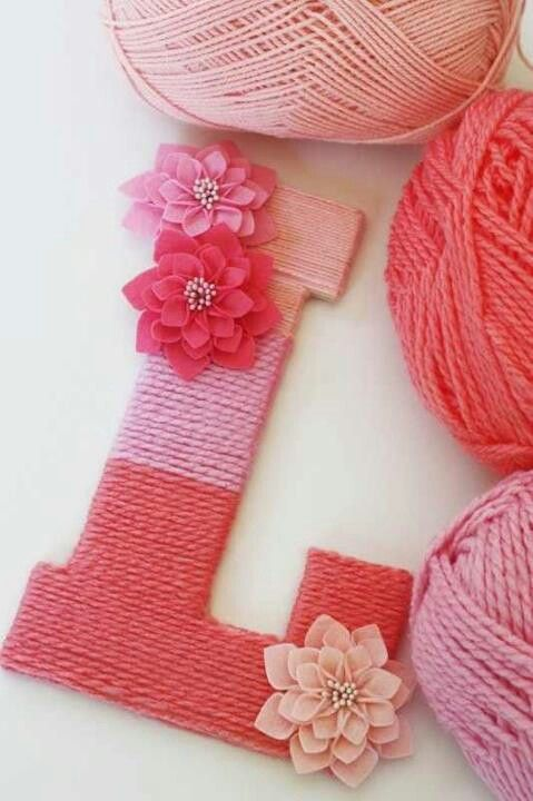 Wooden letter with yarn wrapped around it. Cute idea