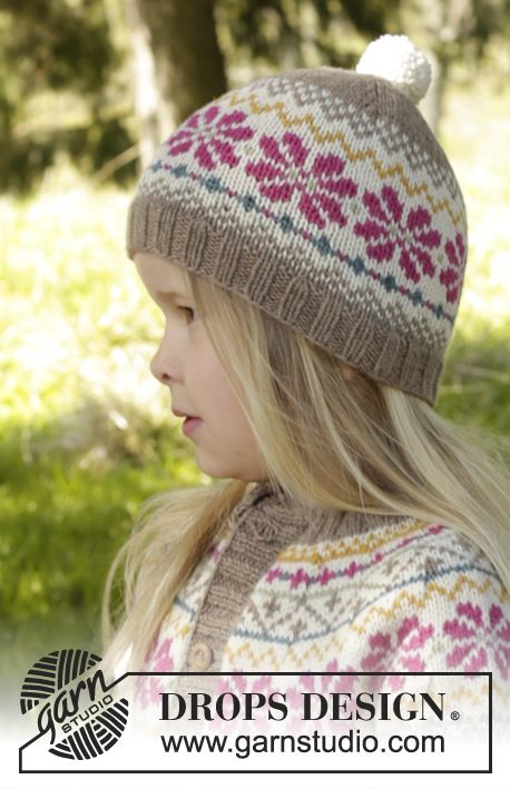 "Knitted DROPS hat with Nordic pattern and pompoms in ""Lima"". Size 3 ..."