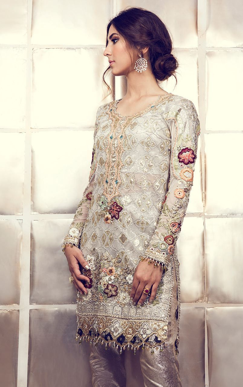 935607f3e0 This Pakistani Designer suit is in white gorgette and all the embroidery is  in Hand. Pant is in shimmer fabric. This suit can be customised in any  color of ...