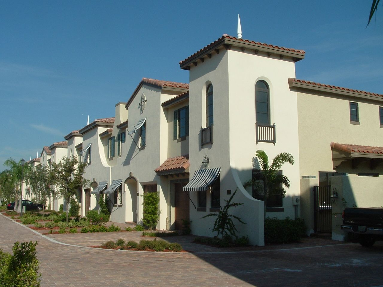Villagio del Mar Forty-six town homes nested on a single street terminated by upscale products to create a soft residential feel.  Particular attention was paid to minimizing front doors and garages.