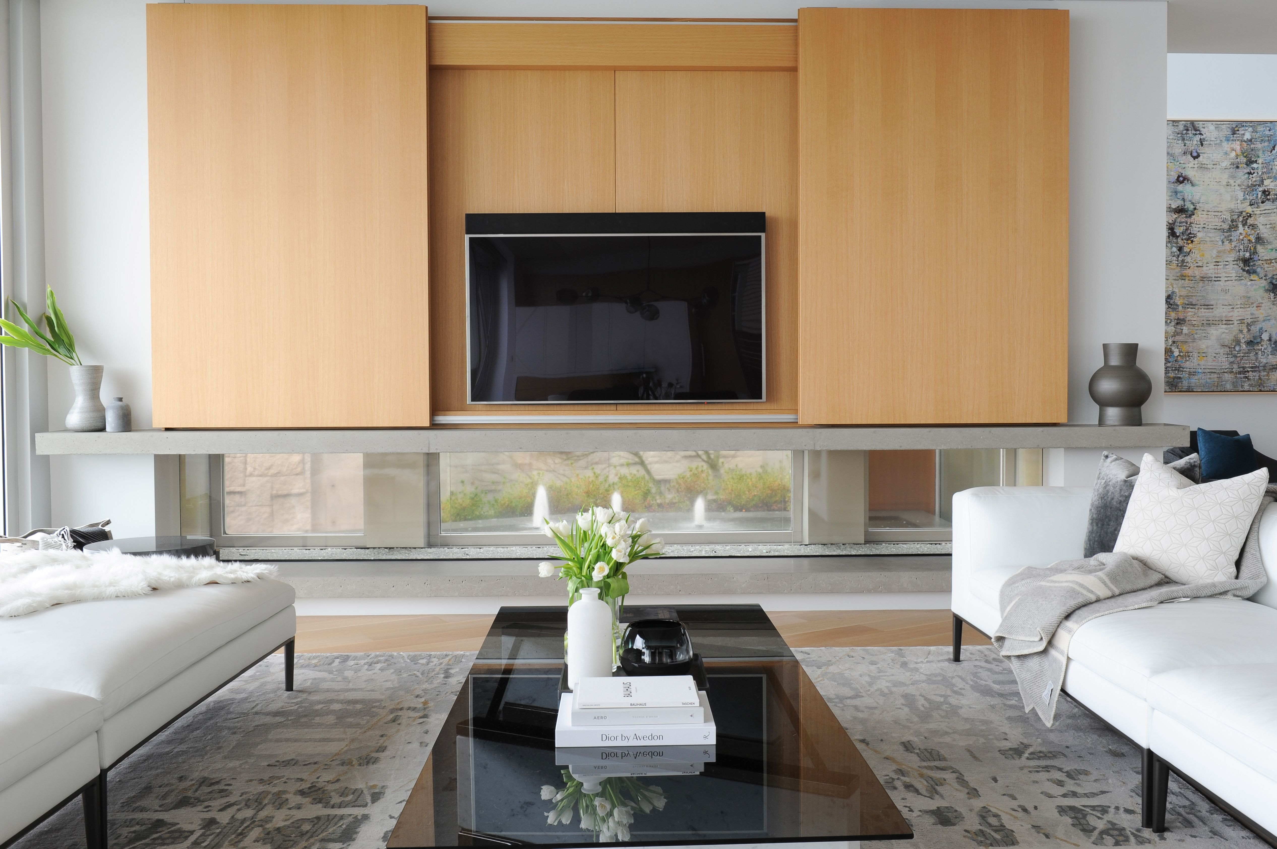 FDNA Architecture added wood paneling with a hidden function of hiding the TV. #FormfollowsFunction