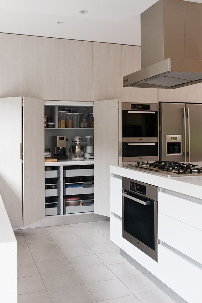 Appliances hidden away, drawers for misc items. With cabinet doors that can be opened and slide in to a gap on the side so they are out of the way