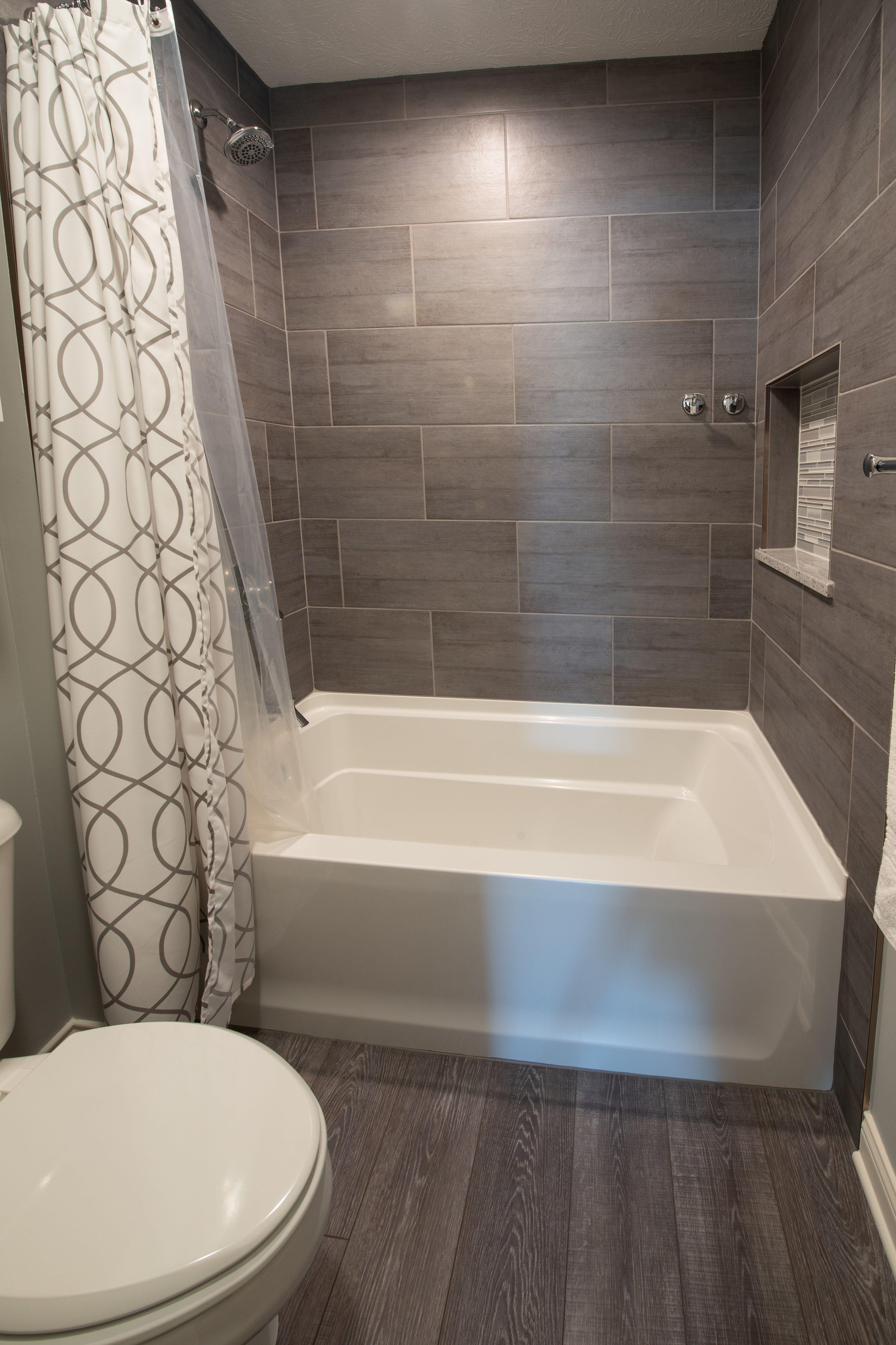 Guest Bathroom Remodel In Indiana Wood Floors Subway Tile Wall In Tub Shower Guest Bathroom Small Guest Bathroom Remodel Bathroom Remodel Shower