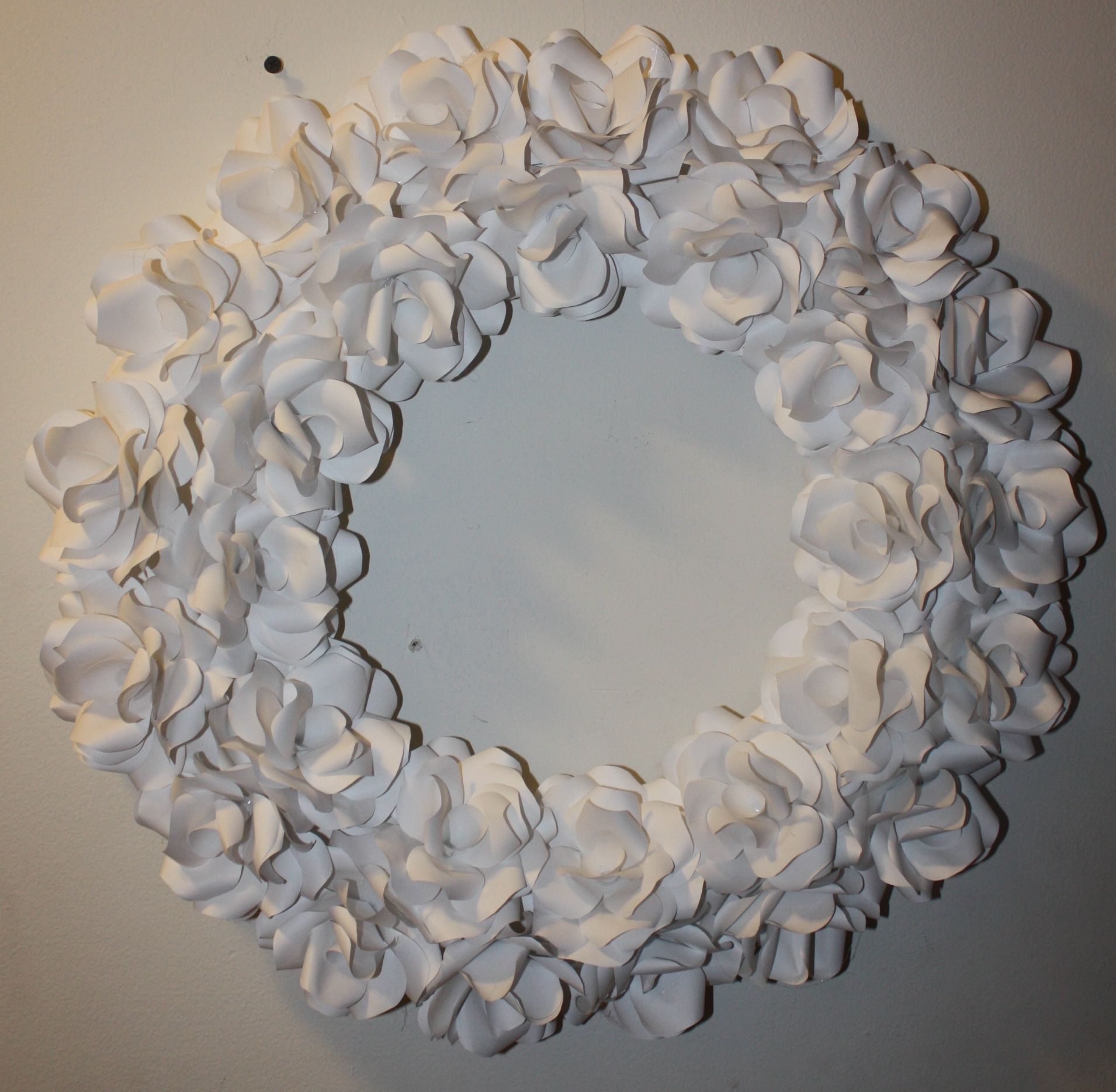 DIY Paper Flower Wreath I used printer paper and a glue gun to make this wreath