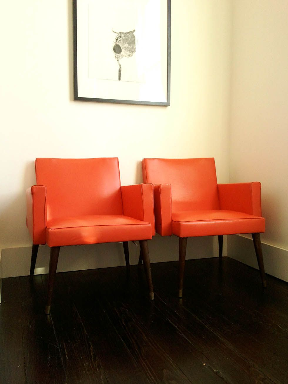 The prettiest orange-red vinyl chairs.  Wayfair living room