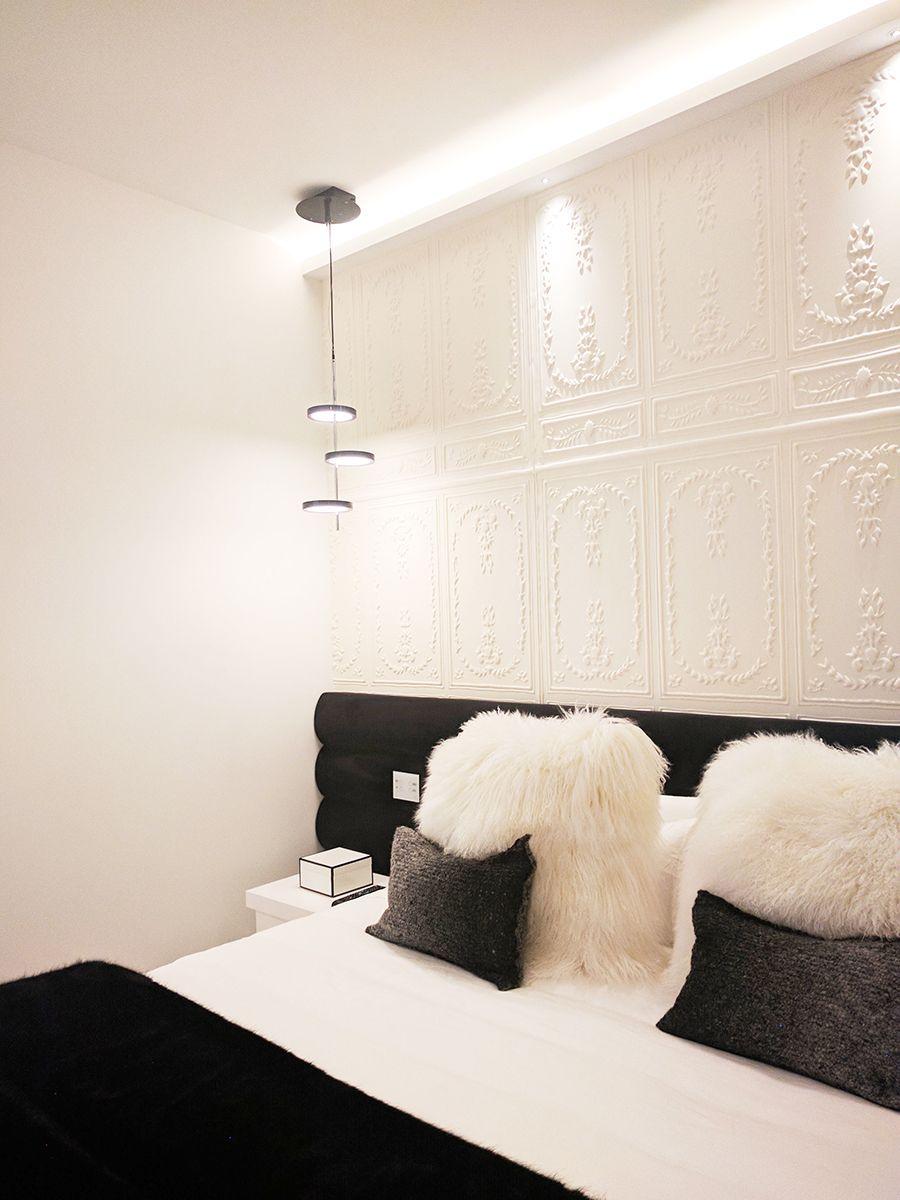 Dormitorio blanco y negro con iluminaci n indirecta sobre cabecero mediante candileja que oculta - Iluminacion indirecta dormitorio ...