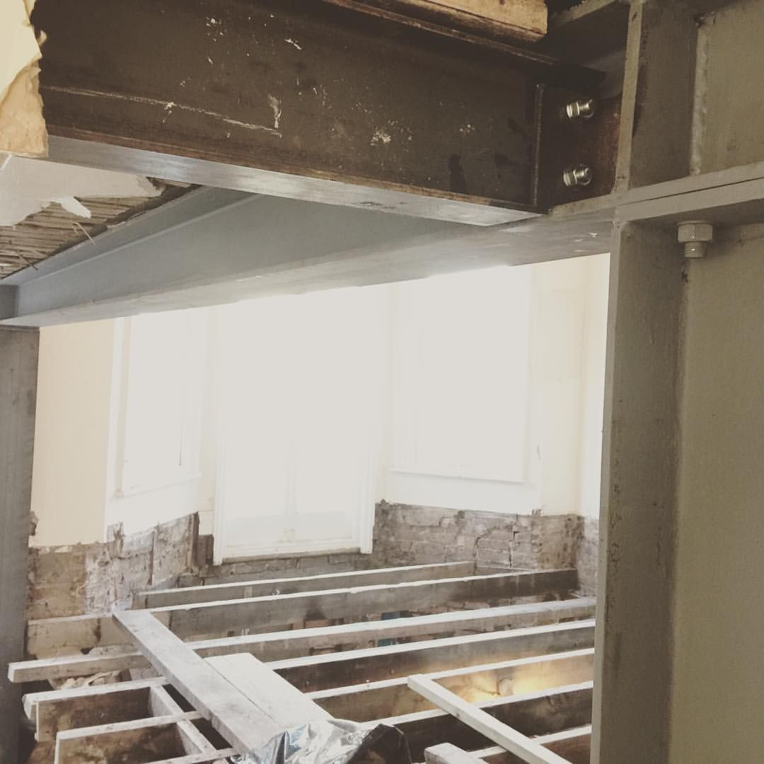 RSJ steel beam installation. Box frame installation with horizontal ...