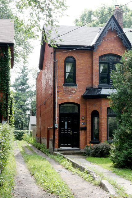 RED BRICK HOUSES WITH BLACK TRIM