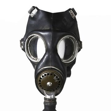 """An actual vintage gas mask for Halloween.  """"This British-made WWII Mark III gas mask was introduced to provide a gas mask with an able speech diaphragm.  Includes canister and canvas storage bag. This gently used vintage product is in good condition. Shows some signs of age.""""  Authentic but not very comfy, I'm thinking."""