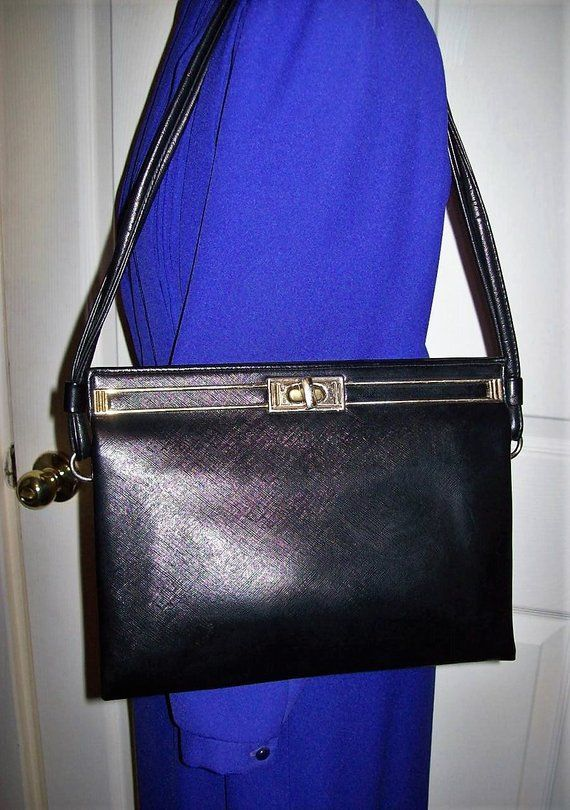 da0c9fdec5f2 Vintage 1960s Black Vinyl Shoulder Bag w  Brass Accents Hippie Mod Only 12  USD  vintage  purse  shoulderbag