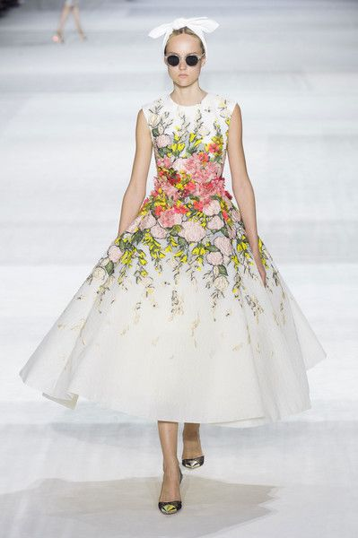 Giambattista Valli at Couture Fall 2014. This dress resembles a 1950s daydress. The wide, circle skirt that likely has layers of crinoline underneath, as well as the higher neckline, are aspects that are parallel to aspects of fashion in the 1950s. 4.6.15