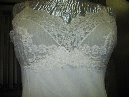 Vintage 1960's Vassarette Slip, White Lace, Ladies Size 34 A, Lingerie, Sexy, retro 60's Ladies undergarment Fashion Design Style  Note: this is used, comes with some wear. White slip with a wide lace trim on the hemline and a lace bodice that is lined with chiffon in the cups. Adjustable ribbon straps with plastic slides.   From the Roland Dressler Collection  http://RolandDressler.blogspot.com   Selling on Etsy   http://TheIDconnection.etsy.com