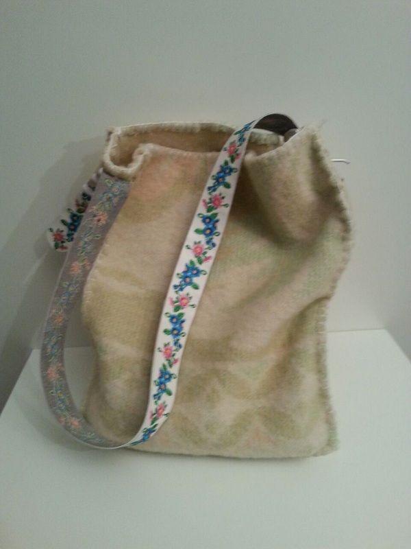 tas van oude deken en riem
