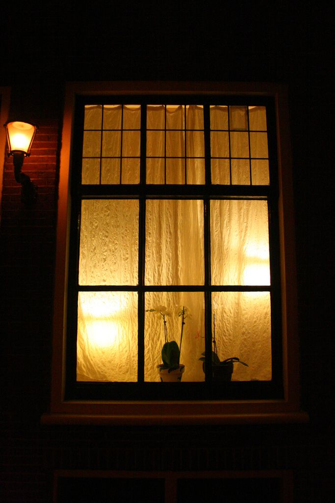 Looking through night windows, lit with golden lights... A ...