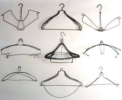 I would love to find a bunch of vintage hangers to hang as a border ...