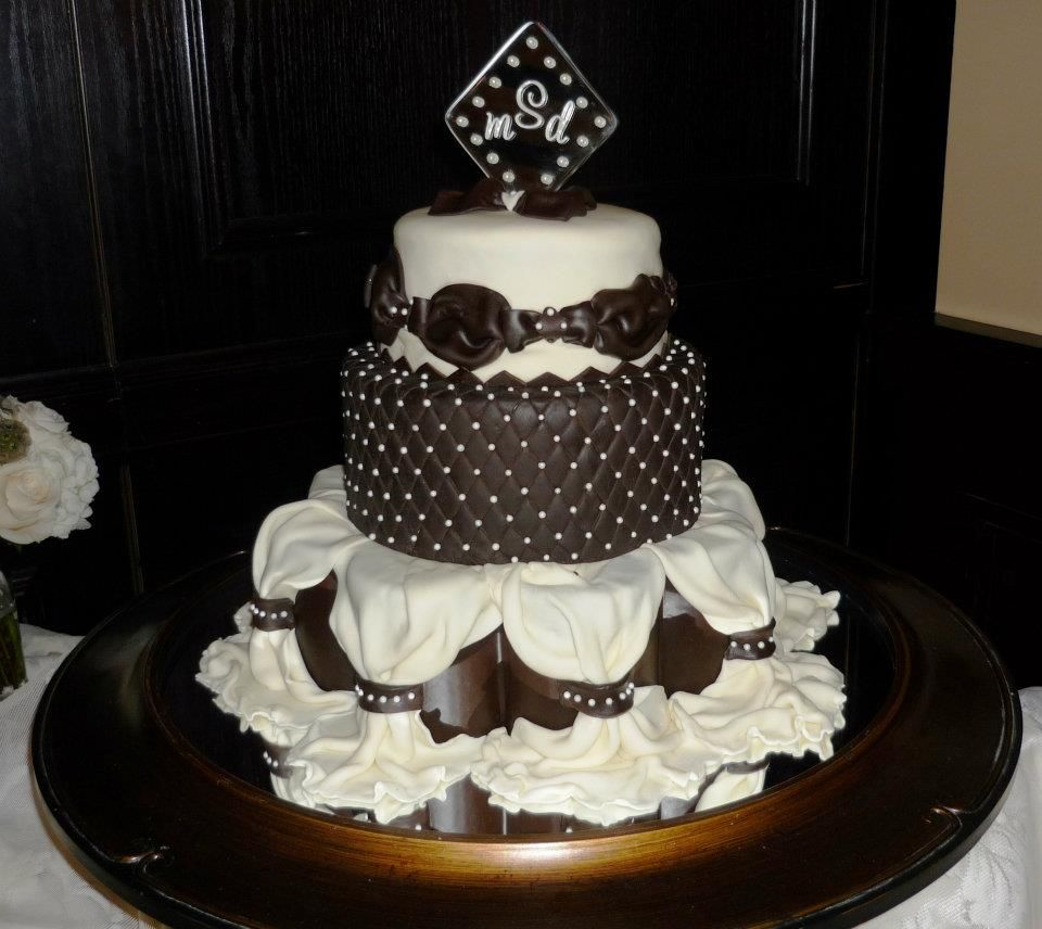 Ivory and brown wedding cake draped with edible pearls