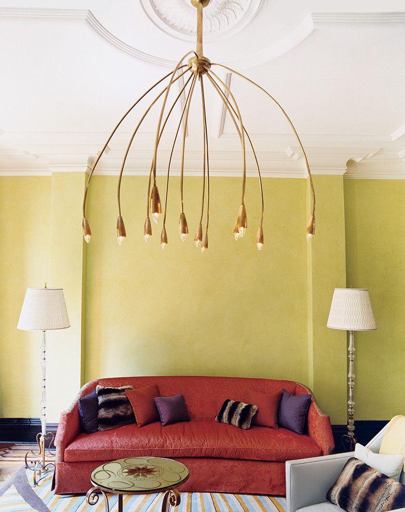 yellow living room with russet red sofa, pantone chili oil, orangish ...