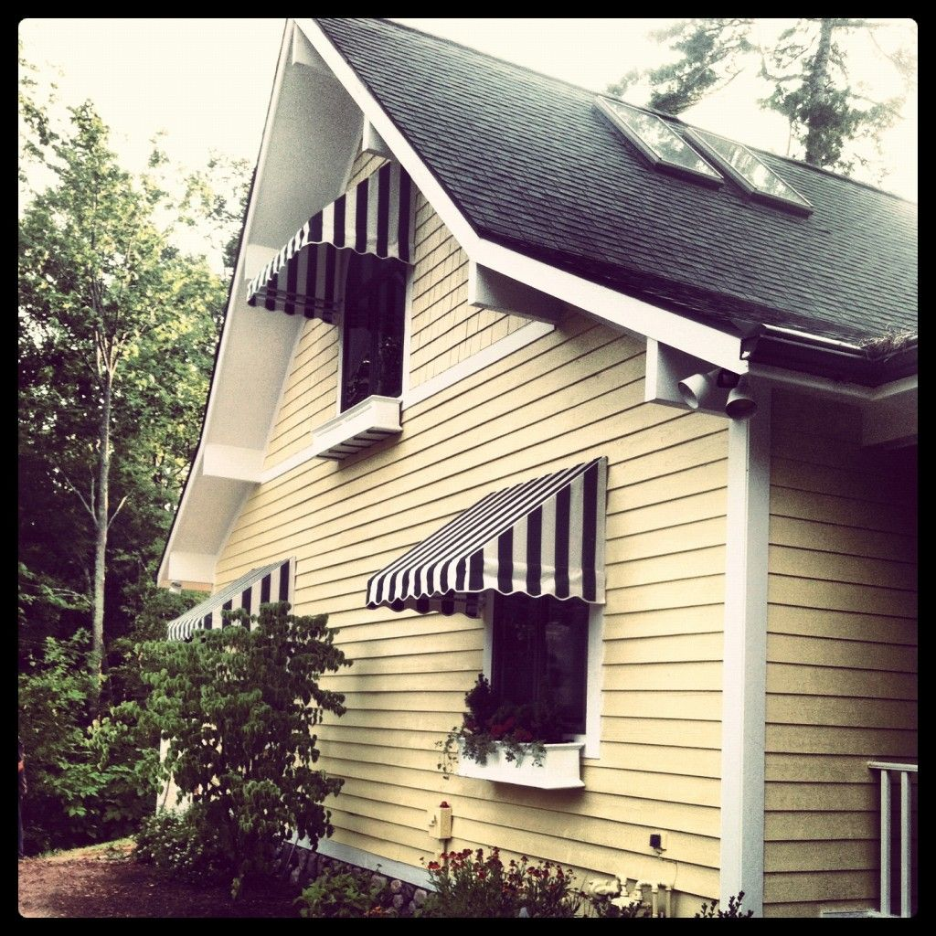 Paint The House Yellow, Trim White, And Paint The Metal Awnings Black And  White