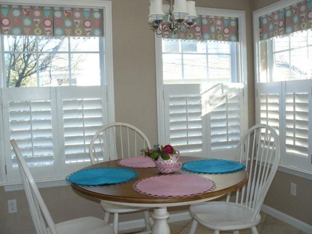 Cafe' Shutters with a fabric valance. Really like these ...