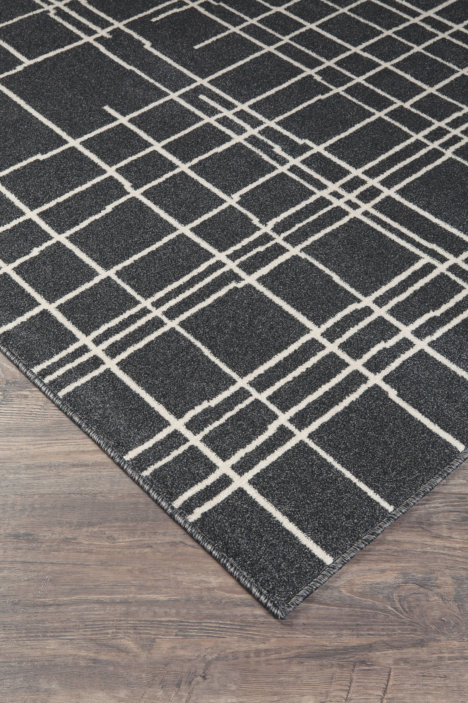 Jai Black White Large Rug This Rug S Abstract Pattern Is Certainly A Sight For Sore Eyes Spindled Cross Hat Signature Design By Ashley Signature Design Rugs