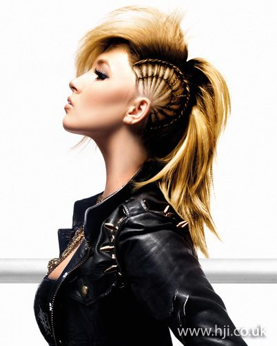 2011 Mohawk long blonde hairstyle    Hair was divided off in to two sections. The lower section was braided into round plaits on the scalp, with the lengths secrued in a ponytail. The top section was then backbrushed and straightened to create a textured quiff.     Hairstyle by: Julian Holland  Hairstyle picture by: Mark Hill  Salon: Mark Hill  Location: Hull