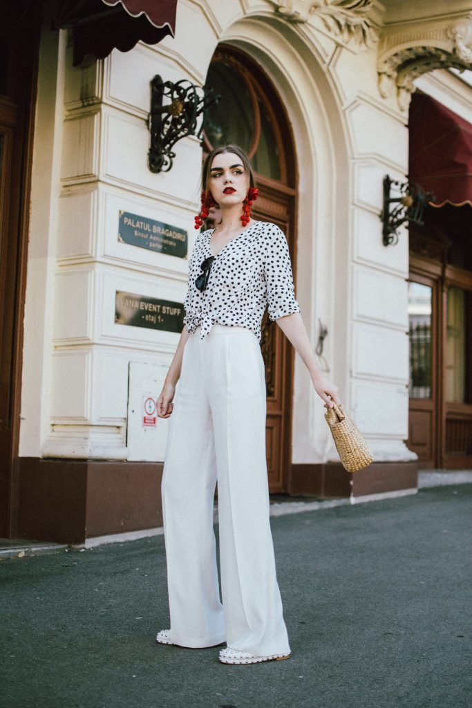 eff083a33b422 Zara white wide leg trousers, polka dot tie front shirt, basket bag, white  leather flat studded mules, statement red earrings, spanish inspired  earrings h&M ...