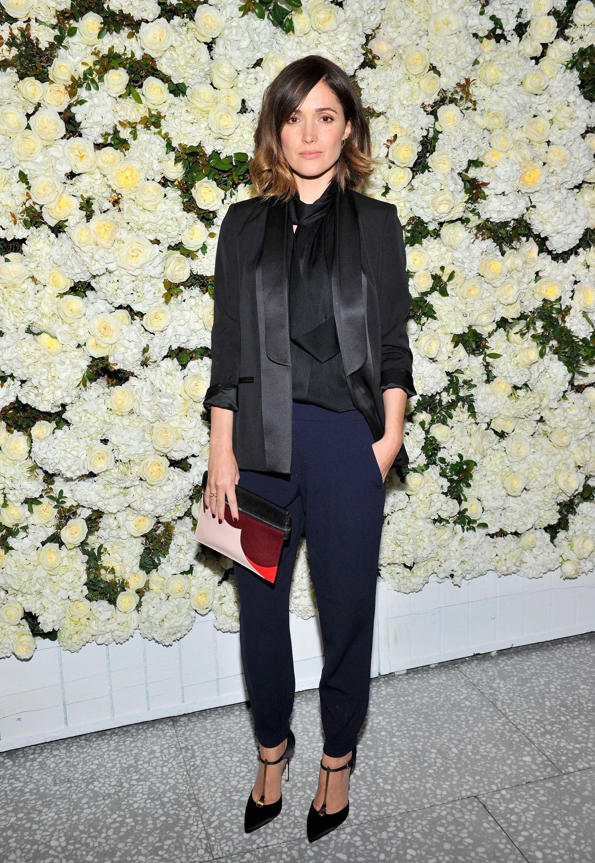 Rose Byrne in a Victoria Beckham jacket, top, and bag