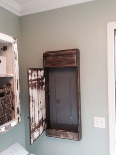 my hubby made this sweet distressed door cover for the Small Laundry Room Makeovers Basement Laundry Room Ideas