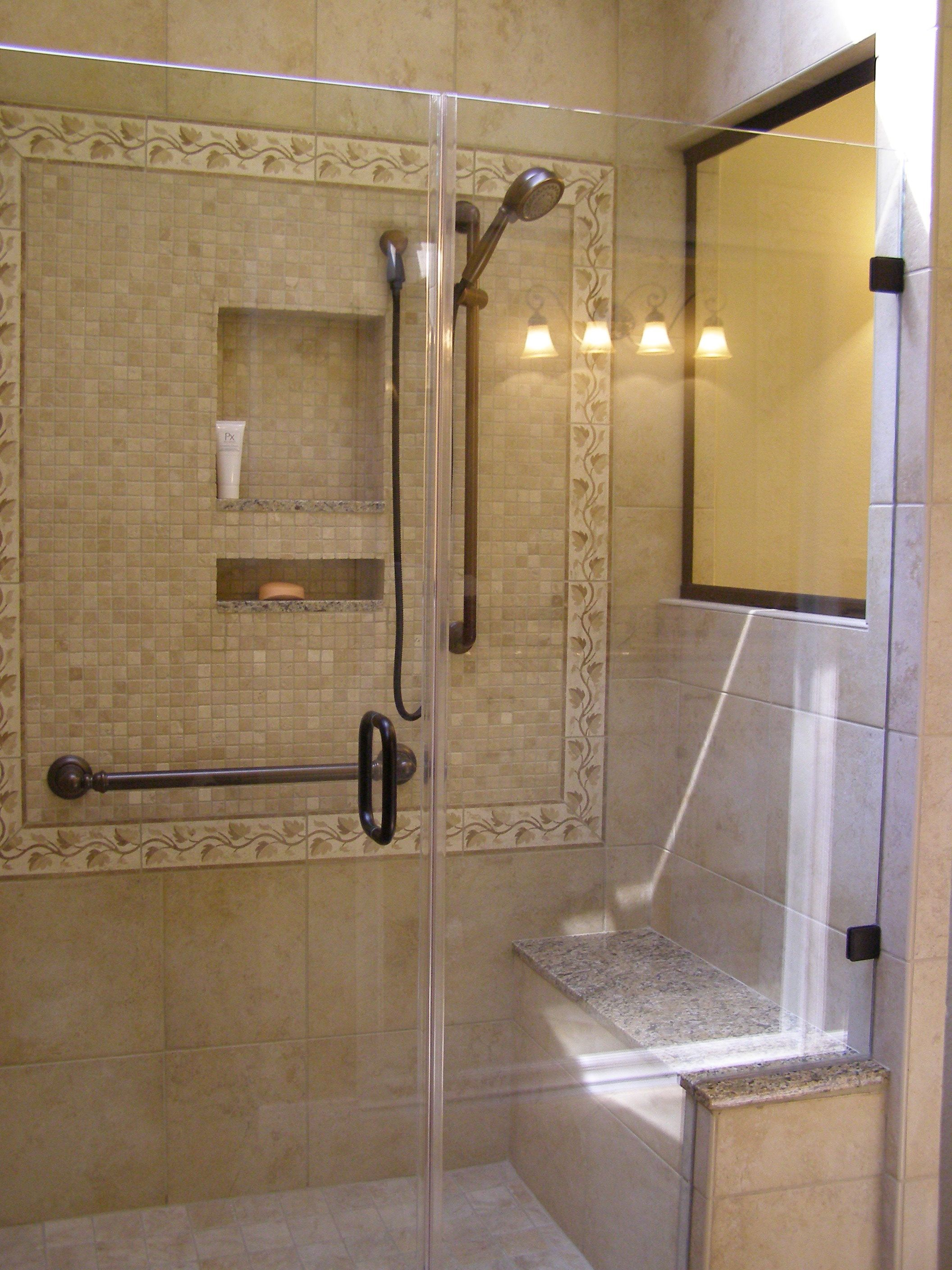 Shower with heavy frameless shower enclosure and mosaic tile deco\'s ...