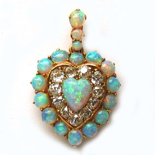 A VICTORIAN OPAL AND DIAMOND HEART PENDANT Circa 1860