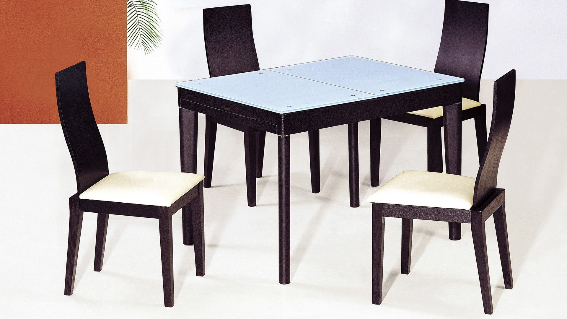 "AtHome DT6016+ DC3041C Diningroom Set - This DT6016 EXTEND-ABLE dining room table is a simple and functional design, perfect match for a small modern dining place. This DT6016 dining room table has an extend-able wooden body and glass top with a unique and functional combination. Extension to 71''. Also available in shiny white. Size : Dining Table : 42"" / 71"" x 32"" x 30"" Chair : L19'' X W18.5'' X H 37.5''"